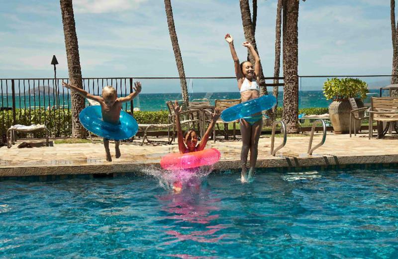 Jumping in the pool at Mana Kai Maui.