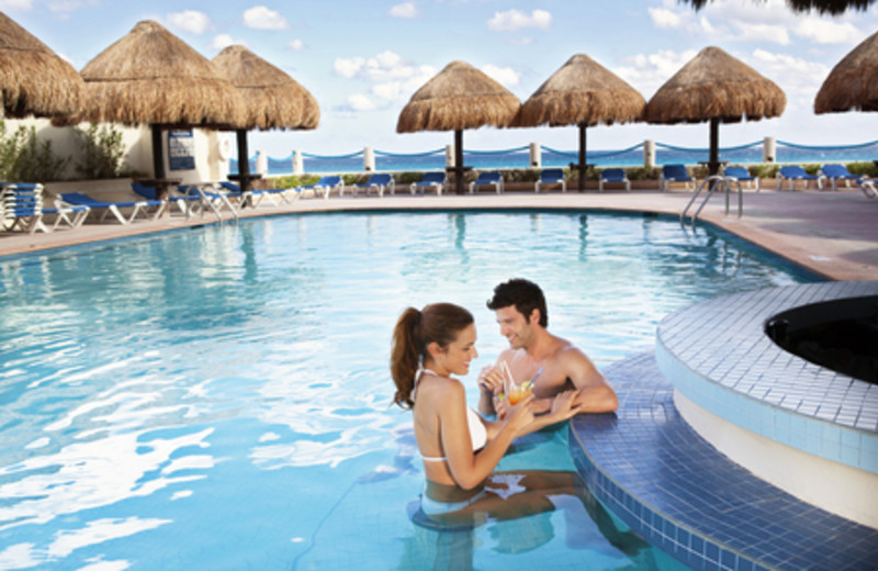 Relax in the Pool at Barcelo Tucancun Beach