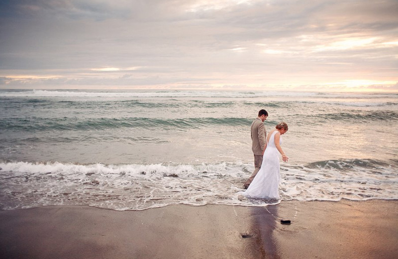 Wedding couple on the beach at Bella Beach Property Management.