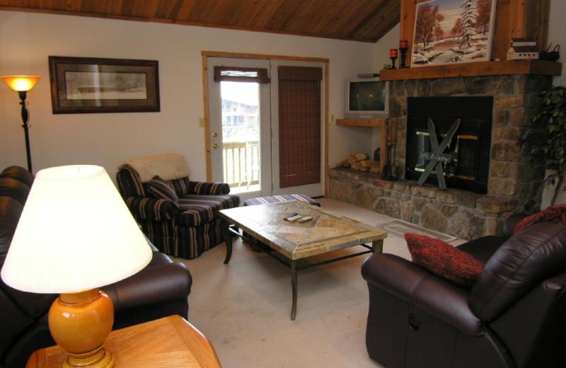 Vacation rental living room at Timberline Herzwoods and Northwoods Resort.