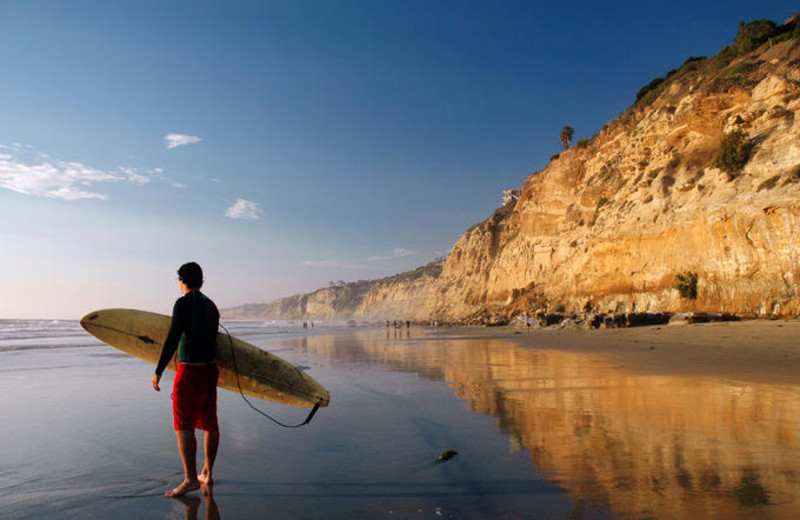 Surfing near Pismo Lighthouse Suites