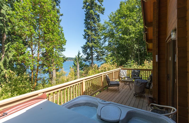 Rental deck with hot tub at Sequim Valley Properties.