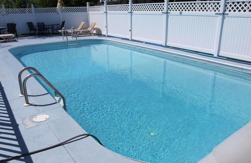 Outdoor pool at Mackenzie's Cottages, Motel & Suites.
