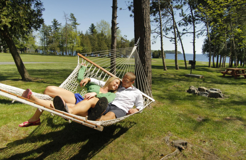 Couple in hammock at Bluff Point Golf Resort.
