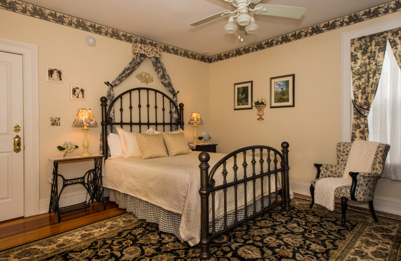 Offers a bold queen-size iron bed, a quaint Victorian accent chair and a fireplace. The Clement Room is tastefully decorated in Victorian cream and black toil 'e. En suite bath features an antique claw foot tub/shower.
