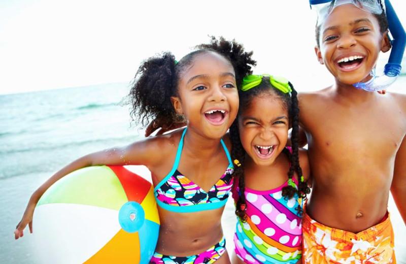 Family on the beach at Avista Resort.