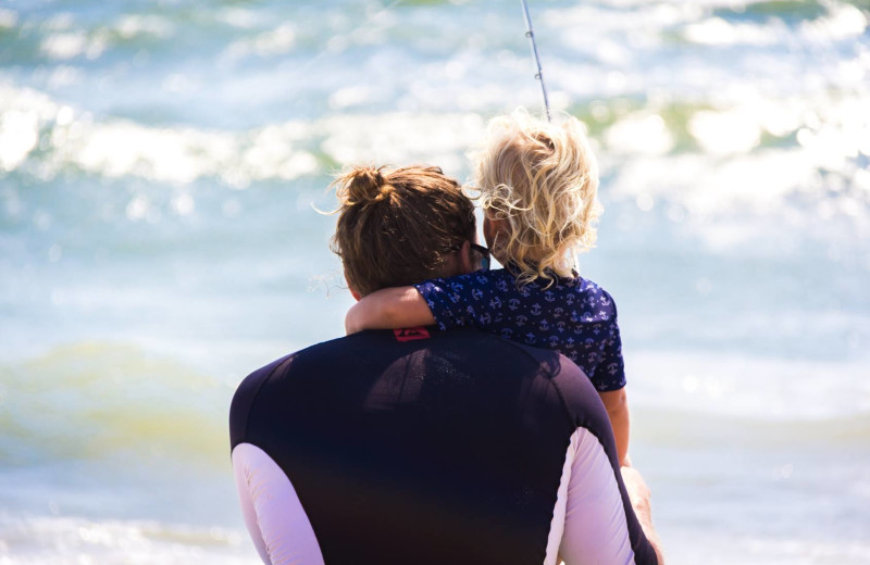 Family on beach at Realty World - First Coast Realty.