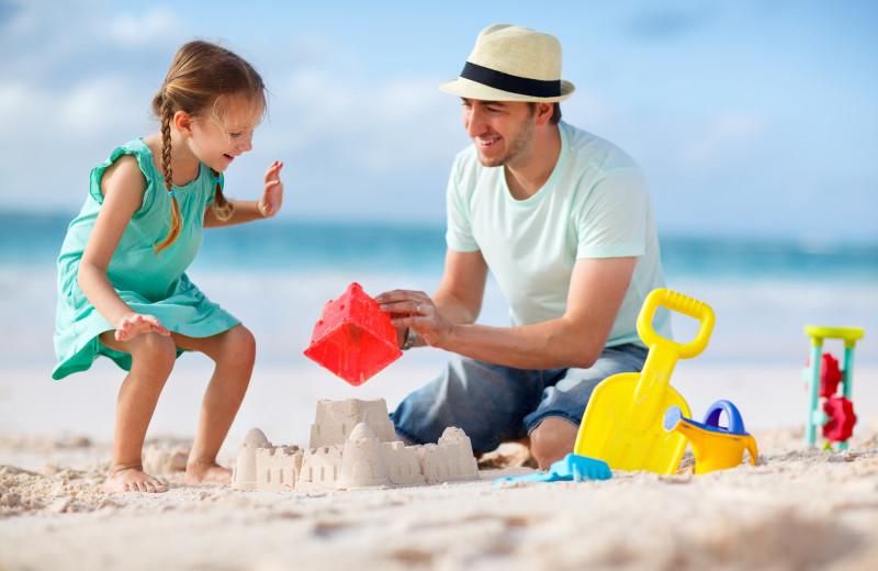 Family on beach at Gary Greene Vacation Rentals.