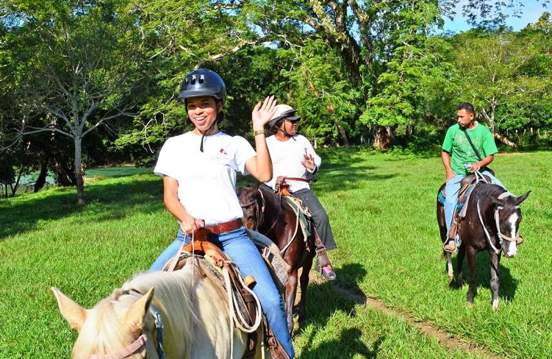 Horseback riding at San Ignacio Resort Hotel.