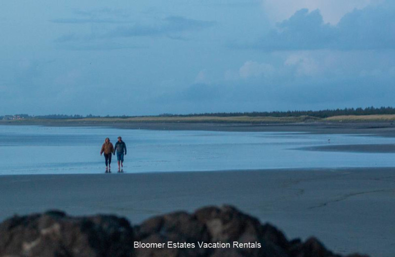 Couple on beach at Bloomer Estates Vacation Rentals.