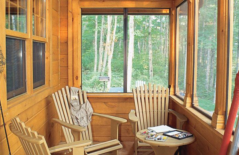 Cabin porch at Fairmont Kenauk at Le Chateau Montebello.