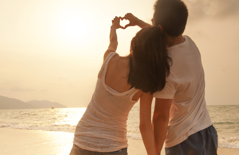 Couple on beach at CBVacations.com