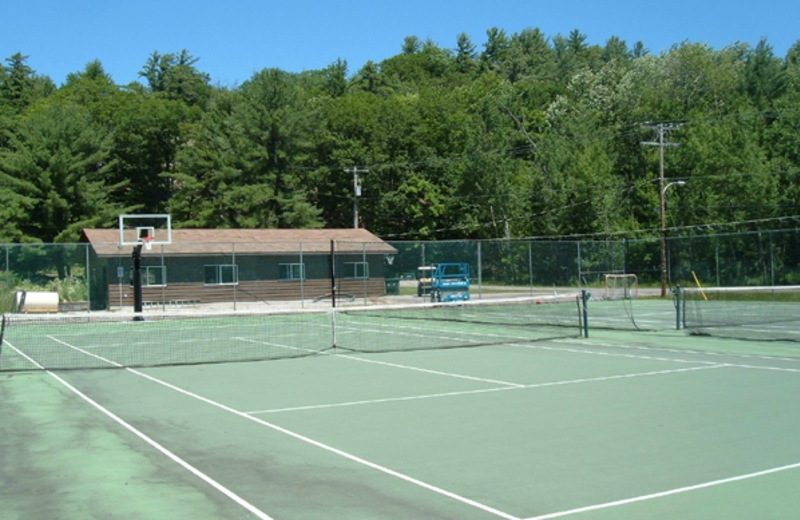 Tennis court at Paquana Cottage Resort.