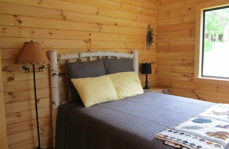 Cabin bedroom at Niemeyer's Rugged River Resort.