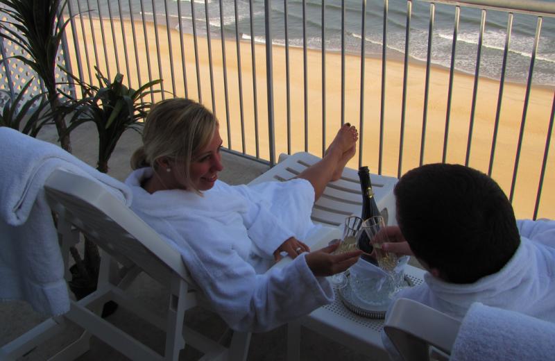 Honeymoon couple enjoying the beach view at Grand Hotel & Spa.