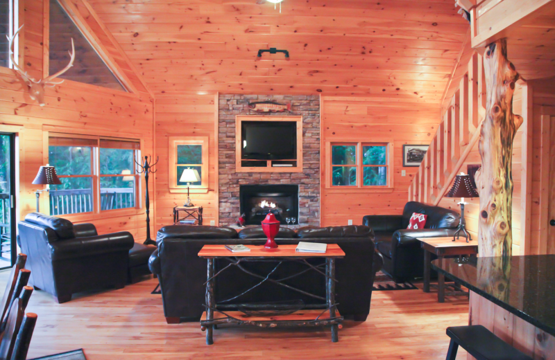 Cabin living room at Mountain Getaway Cabin Rentals.