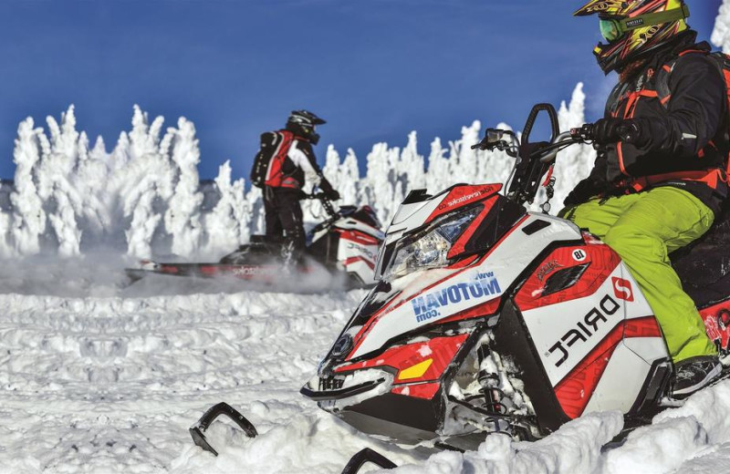 Snowmobiling at Glacier House Resort.