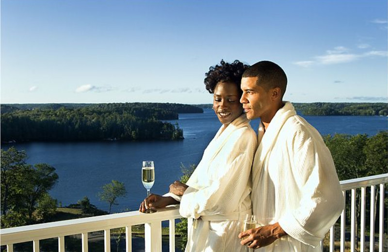 Couple on balcony at The Rosseau, A JW Marriott Resort & Spa.