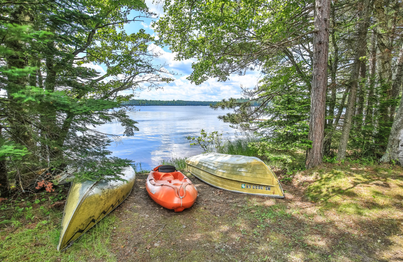 Lake and kayaks at Hiller Vacation Homes.