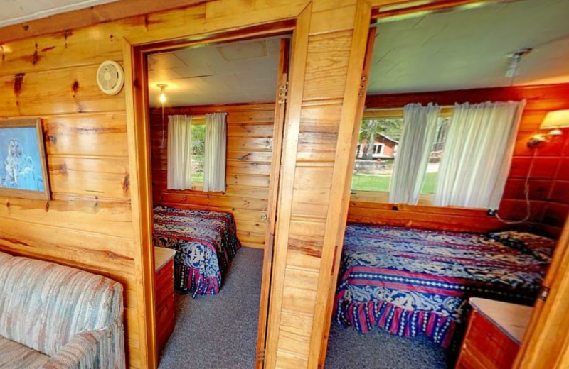 Cabin bedrooms at Hiawatha Beach Resort.