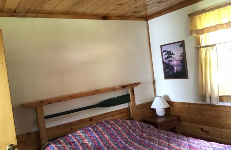 Cabin bedroom at Driftwood Resort.