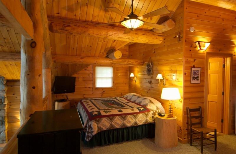 Cabin bedroom at Trout House Village Resort.