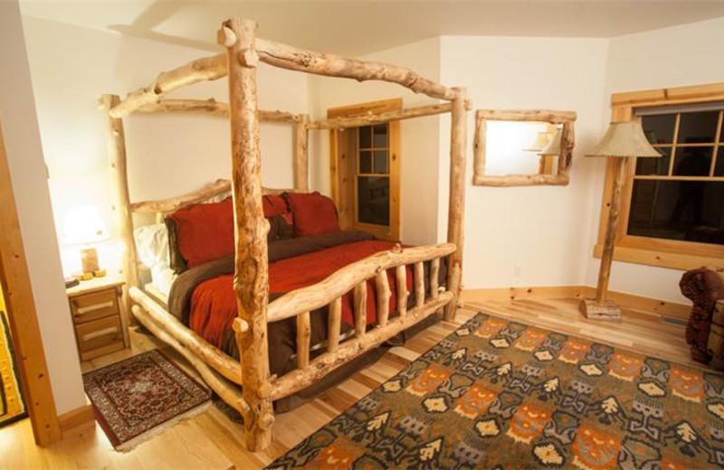 Rental bedroom at Rendezvous Mountain Rentals & Management.