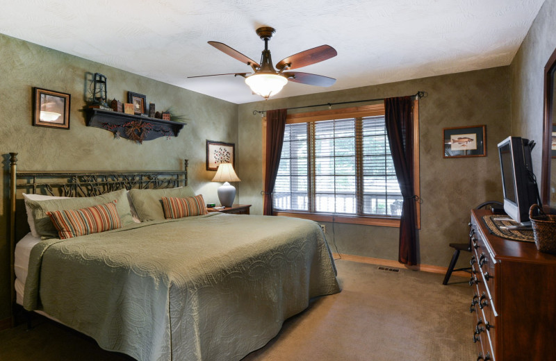Rental bedroom at Amazing Branson Cabin Rentals - RentBranson.