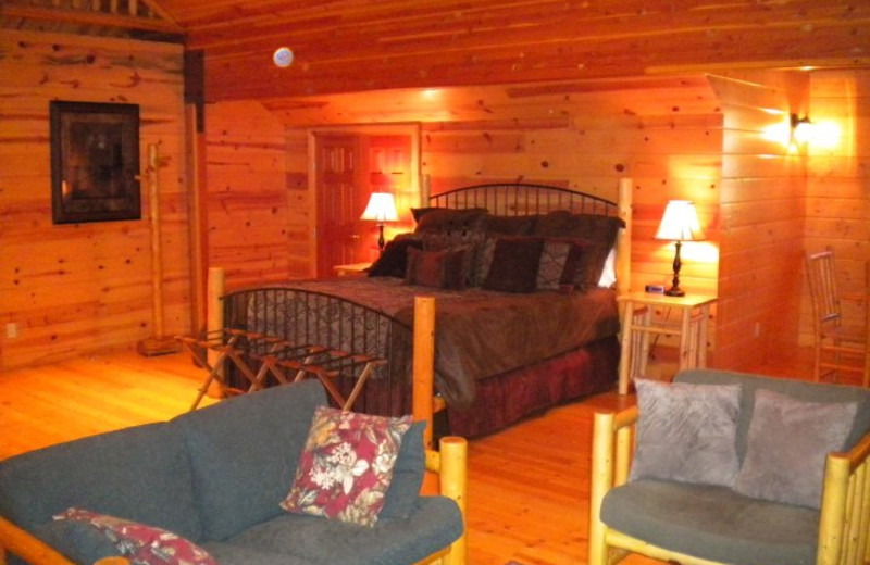 Cabin bedroom at Mountain Springs Lodge.