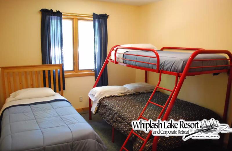 Cabin bedroom at Whiplash Lake Resort.