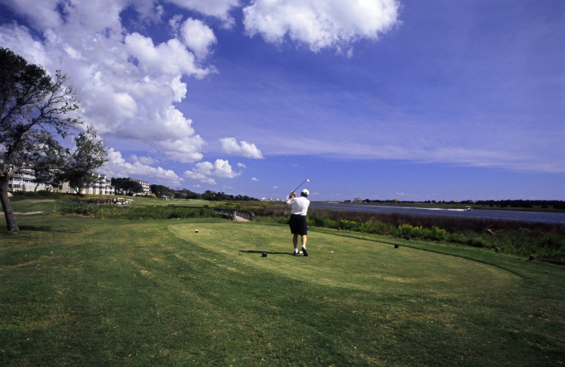 Playing golf at Ocean Isle Inn.