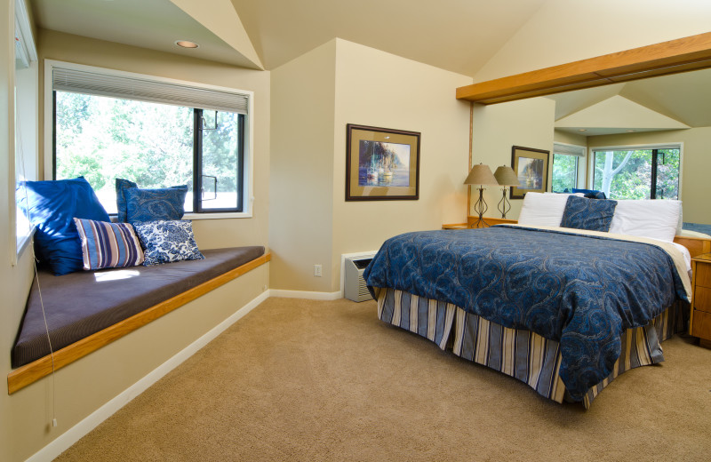 Hotel room with queen bed, window seat, coffee maker and mini fridge at Mount Bachelor Village Resort.
