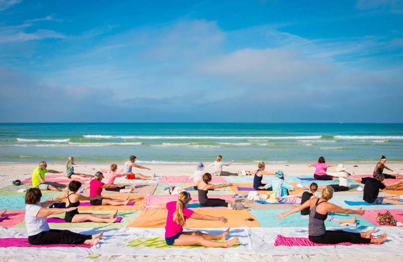 Beach yoga at Tropical Shores Beach Resort.