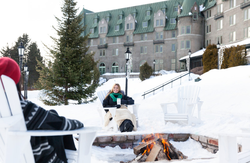 Relaxing by the fire at Fairmont Le Manoir Richelieu.