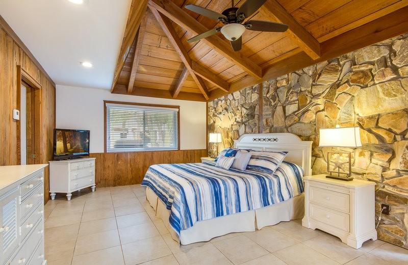 Rental bedroom at Sun Palace Vacation Rentals.
