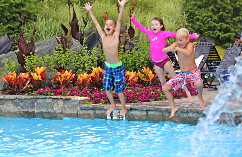 Kids jumping in pool at Minerals Hotel.