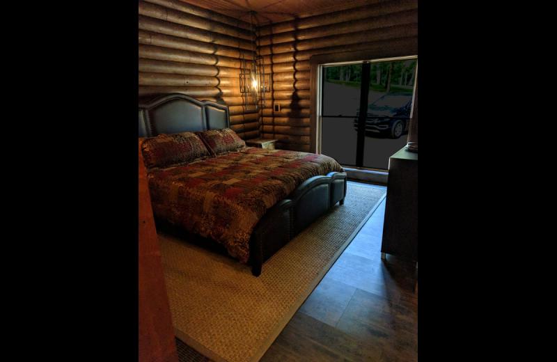 Cabin bedroom at Chateau Lake Logan.