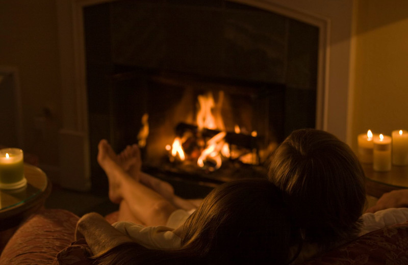 Couple by fireplace at Cottage Grove Inn.