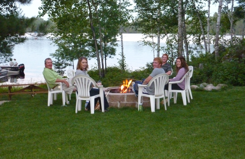 Group by the fire at River Point Resort & Outfitting Co.