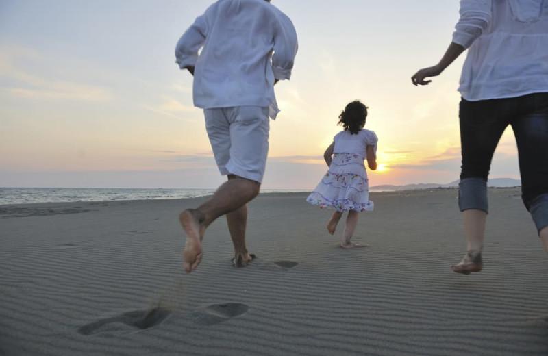 Family on beach at Shangri La Motel.