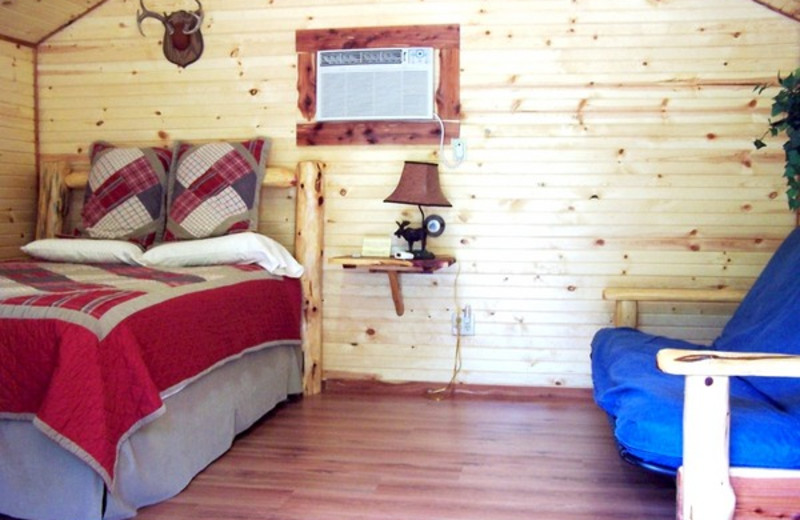 Cabin bedroom at Copper John's Resort.