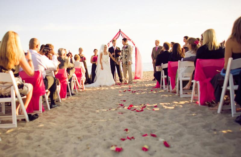 Beach wedding at Fess Parker's Doubletree Resort.