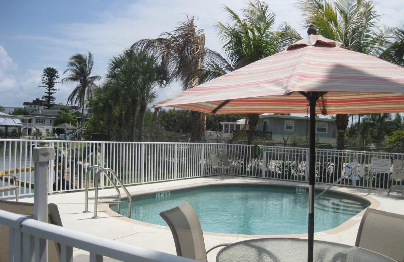 Outdoor pool at Island Breeze Vacation Rentals.