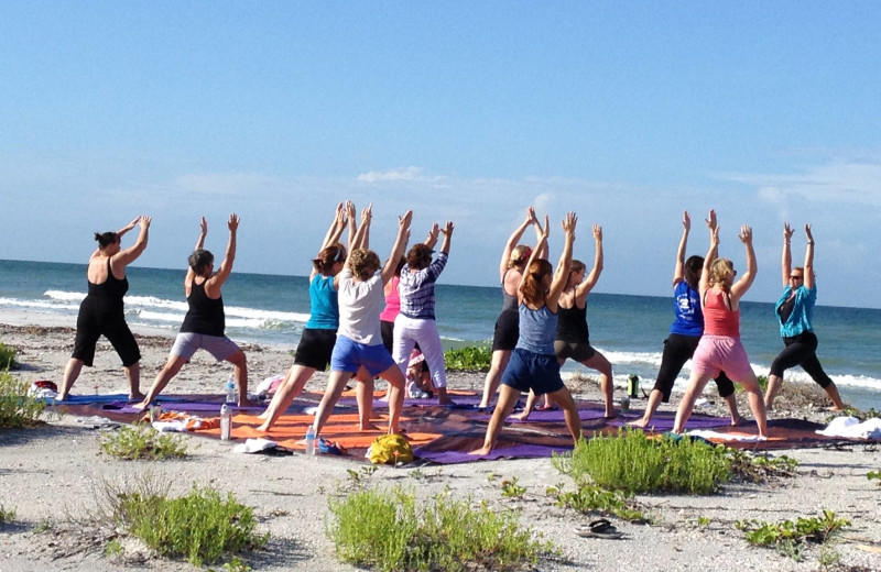 Beach yoga at Palm Island Resort.