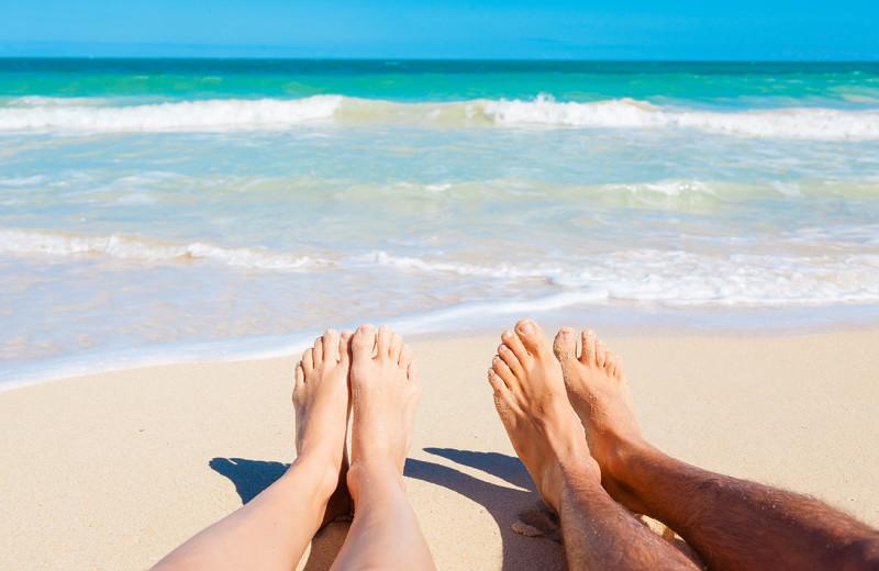 Couple on beach at Beach Realty.