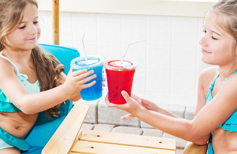 Kids with drinks at Great Blue Resorts- McCreary's Beach Resort.