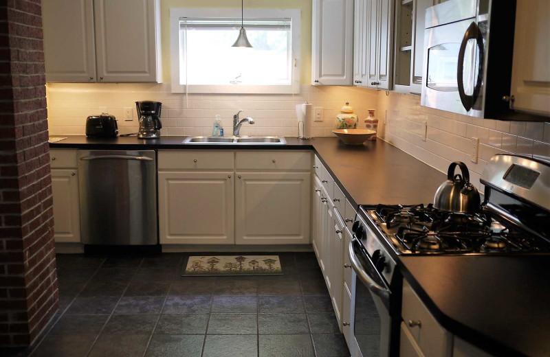 Rental kitchen at Acadia Cottage Rentals.