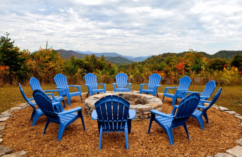 Chairs around fire pit at Splendor Mountain.