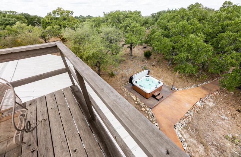 Cabin deck and hot tub at Walnut Canyon Cabins.