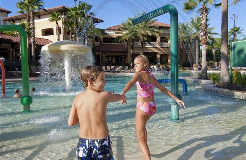 Kids playing at splash pad at Floridays Resort Orlando.